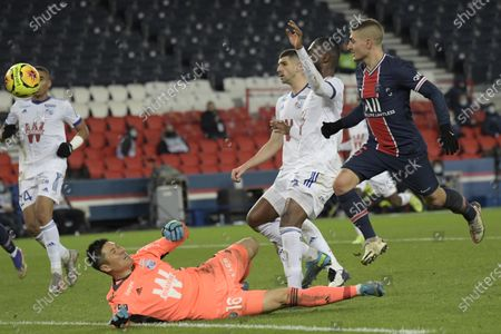 Stock Photo of Paris Saint Germain's Marco Verratti (R) in action against Strasbourg's goalkeeper Eiji Kawashima (down) during the French Ligue 1 soccer match between PSG and Strasbourg at the Parc des Princes stadium in Paris, France, 23 December 2020.