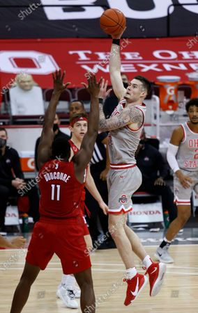 Ohio State forward Kyle Young shoots over Rutgers forward Mamadou Doucoure during the second half of an NCAA college basketball game in Columbus, Ohio, . Ohio State won 80-68