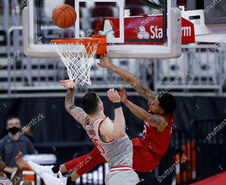 Rutgers guard Jacob Young, right, watches his shot next to Ohio State forward Kyle Young during the second half of an NCAA college basketball game in Columbus, Ohio, . Kyle Young was called for a foul and Jacob Young left the game with an injury