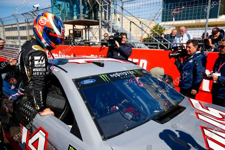 Kevin Magnussen, Haas F1, rides in a NASCAR with Tony Stewart
