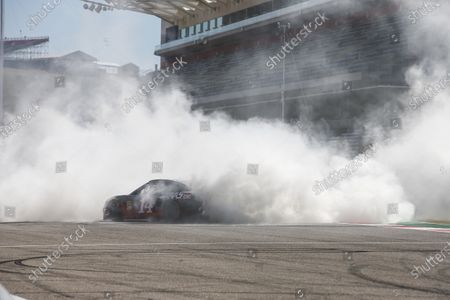Kevin Magnussen, Haas F1, and Romain Grosjean, Haas F1, take it in turns to ride in a NASCAR with Tony Stewart