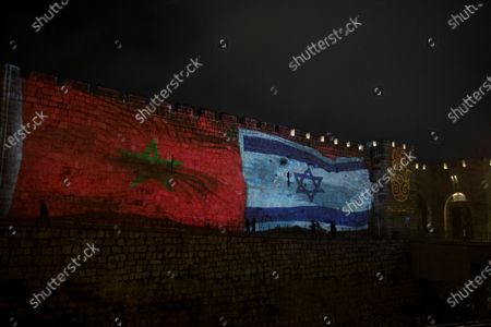 The national flags of Israel and Morocco are projected on the walls of the Old City of Jerusalem, . Senior White House adviser Jared Kushner led a delegation from Israel to Morocco on Tuesday on the first known direct flight since the two countries agreed to establish full diplomatic ties earlier this month as part of a series of U.S.-brokered normalization accords with Arab countries