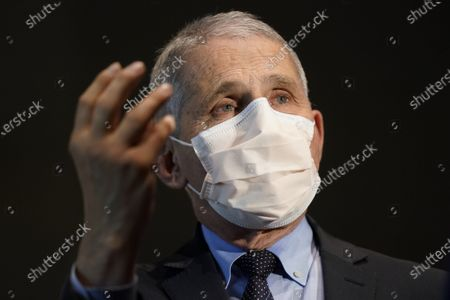 Dr. Anthony Fauci, director of the National Institute of Allergy and Infectious Diseases, speaks with Health and Human Services Secretary Alex Azar before receiving his first dose of the COVID-19 vaccine at the National Institutes of Health, Tuesday, December 22, 2020, in Bethesda, Maryland. Fauci and Azar received the Moderna vaccine, one of two available at the moment, the other from Pfizer-BioNTech.