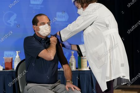 Health and Human Services Secretary Alex Azar receives his first dose of the COVID-19 vaccine at the National Institutes of Health, Tuesday, December 22, 2020, in Bethesda, Maryland. Azar and Dr. Anthony Fauci received the Moderna vaccine, one of two available at the moment, the other from Pfizer-BioNTech.