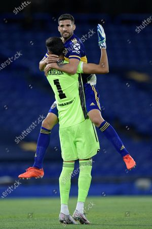 Lisandro Lopez of Argentina's Boca Juniors celebrates with goalkeeper Esteban Andrada goalkeeper after their teammate Eduardo Salvio scores the opening goal against Argentina's Racing Club during a Copa Libertadores quarterfinal second leg soccer match at the Bombonera stadium in Buenos Aires, Argentina