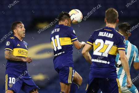 Eduardo Salvio of Argentina's Boca Juniors heads the ball to score his side's opening goal against Argentina's Racing Club during a Copa Libertadores quarterfinal second leg soccer match at the Bombonera stadium in Buenos Aires, Argentina