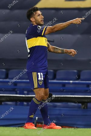 Eduardo Salvio of Argentina's Boca Juniors celebrates scoring his side's opening goal against Argentina's Racing Club during a Copa Libertadores quarterfinal second leg soccer match at the Bombonera stadium in Buenos Aires, Argentina