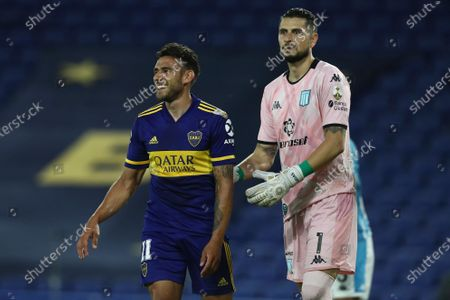Eduardo Salvio of Argentina's Boca Juniors celebrates scoring his side's opening goal goal next to goalkeeper Gabriel Arias of Argentina's Racing Club during a Copa Libertadores quarterfinal second leg soccer match at the Bombonera stadium in Buenos Aires, Argentina
