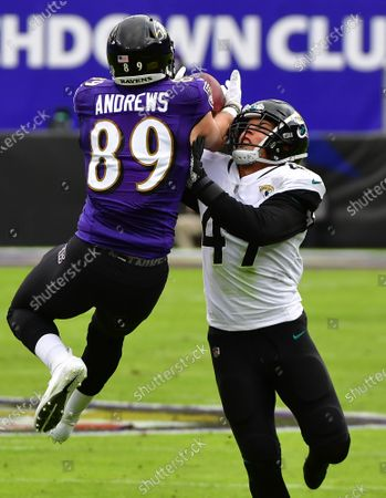 Baltimore Ravens tight end Mark Andrews (89) wrestles with Jacksonville Jaguars linebacker Joe Schobert (47) for a first down pass reception during the first half at M&T Bank Stadium in Baltimore, Maryland, on Sunday, December 20, 2020.