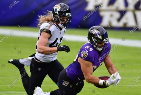 Jacksonville Jaguars safety Andrew Wingard (42) is called for pass interference against Baltimore Ravens tight end Mark Andrews (89) during the first half at M&T Bank Stadium in Baltimore, Maryland, on Sunday, December 20, 2020.