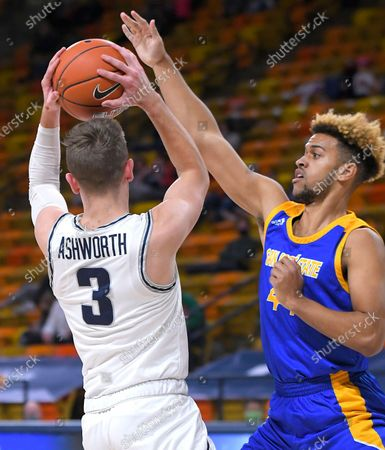 Utah State guard Steven Ashworth (3) looks to pass the ball as San Jose State guard Trey Smith (44) defends during the first half of an NCAA college basketball game, in Logan, Utah