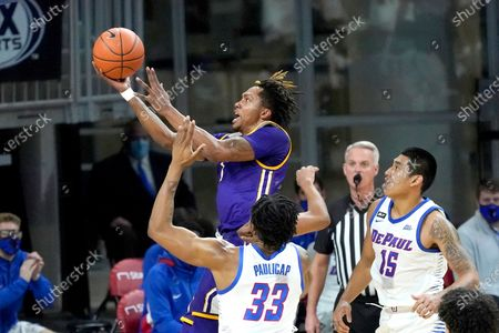 Western Illinois' Anthony Jones drives to the basket past DePaul's Pauly Paulicap (33) and Oscar Lopez Jr. during the first half of an NCAA college basketball game, in Chicago
