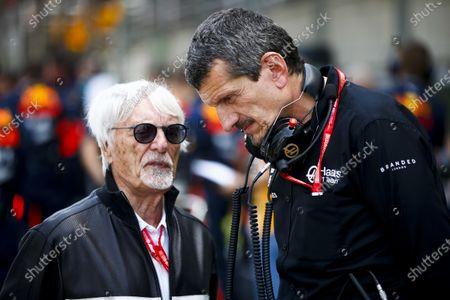 Bernie Ecclestone, Chairman Emiritus of Formula 1 and Guenther Steiner, Team Principal, Haas F1 on the grid