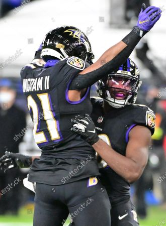 Baltimore Ravens wide receiver Miles Boykin (R) celebrates with running back Mark Ingram (21) after a 13-yard touchdown against the Dallas Cowboys during the first half at M&T Bank Stadium in Baltimore, Maryland, on Tuesday, December 8, 2020.