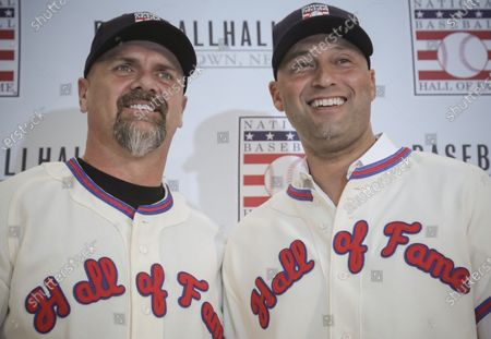 New York Yankees shortstop Derek Jeter, right, and Colorado Rockies outfielder Larry Walker pose after receiving their Baseball Hall of Fame jerseys during a news conference in New York