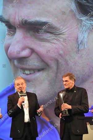 Jonathan Palmer on stage with Gregor Grant Award winner Dick Bennetts