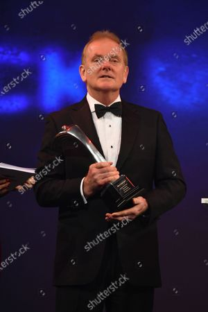 Jonathan Palmer on stage to present a Gregor Grant Award