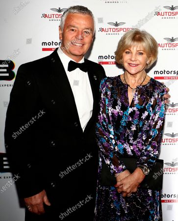Stock Photo of Derek Warwick with wife on arrival