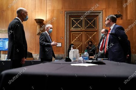 Sen. Rick Scott, R-Fla, and Senate Homeland Security and Governmental Affairs Committee Chairman Ron Johnson. R-Wis, speak to Trump campaign attorneys James Troupis and Jesse Binnall before a hearing to examine the 2020 presidential election in the Dirksen Senate Office Building on Capitol Hill in Washington, DC. The hearing is to examine the alleged claims of election irregularities that have been declared baseless by officials and the courts.