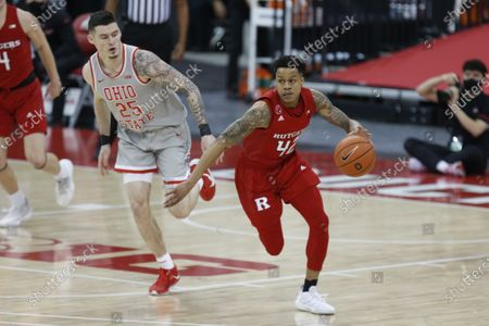 Rutgers guard Jacob Young, right, drives against Ohio State forward Kyle Young during an NCAA college basketball game in Columbus, Ohio, . Ohio State won 80-68