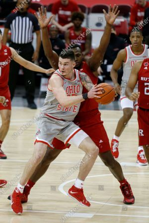 Ohio State forward Kyle Young grabs a rebound against Rutgers forward Mamadou Doucoure during an NCAA college basketball game in Columbus, Ohio, . Ohio State won 80-68