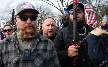 Alex Jones, Infowars radio host, attends a Trump rally on the National Mall in Washington, DC. Large groups of supporters of President Donald Trump are marching on the the Nation's capital as they allege, without evidence, that President-elect Joe Biden stole the U.S. election from Donald Trump.