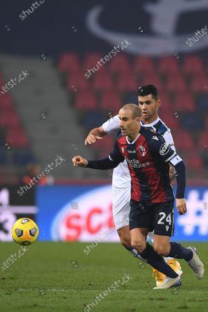 """Rodrigo Sebastian Palacio (Bologna)Gary Medel (Bologna)          during the Italian  Serie A"""" match between Bologna 2-2 Atalanta at  Renato Dall Ara Stadium on December 23 , 2020 in Bologna, Italy."""