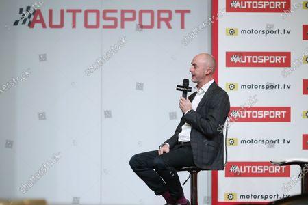 Stock Photo of David Brabham talks on the Autosport stage