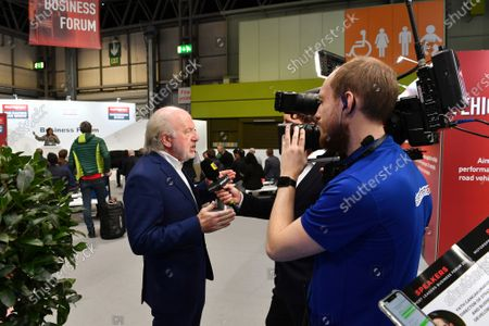 David Richards, chairman of Motorsport UK, talks to the press