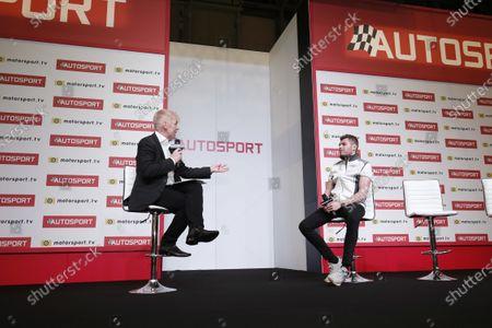 Stock Photo of Presenter Alan Hyde interviews Seb Morris on the Autosport stage