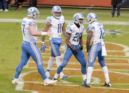 Detroit Lions Marvin Hall (17), Marvin Jones (11) and Mohamed Sanu (12) congratulate Detroit Lions running back Adrian Peterson (28) on his first quarter touchdown against the Chicago Bears at Soldier Field in Chicago