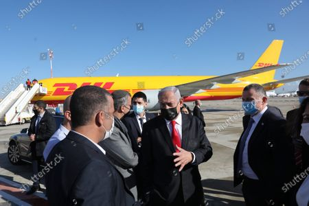 Stock Picture of Israeli Prime Minister Benjamin Netanyahu (R) and his Health Minister Yuli-Yoel Edelstein (L) attend the arrival of the first batch of more than 100,000 doses of Pfizer vaccines after they land at Ben Gurion Airport near Tel Aviv, Israel. The Israeli COVID-19 immunization program is to begin within two weeks.