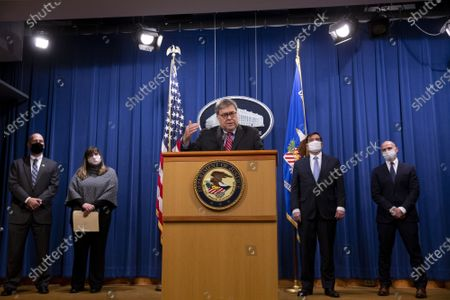 US Attorney General William Barr (C) participates in a news conference to provide an update on the investigation of the terrorist bombing of  Pan Am flight 103 on the 32nd anniversary of the attack, at the US Department of Justice in Washington, DC, on December 21, 2020. The bombing of Pan Am flight 103 occurred December 21, 1988, killing all 259 people on the plane and eleven on the ground. Also in this picture (L to R); Assistant Director in Charge FBI Washington field office Steven D'Antuono; Kara Weipz, representative on behalf of the Pan Am 103 victims and their families; Assistant Attorney General for National Security John Demers; and Acting US Attorney for Washington, DC, Michael Sherwin.