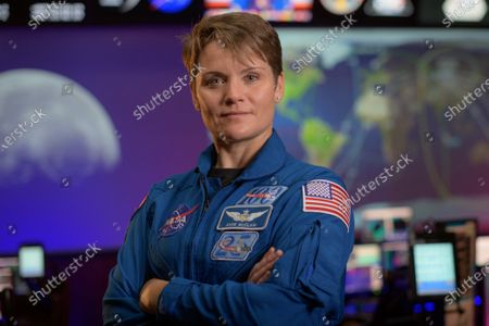 NASA astronaut Anne McClain poses for a portrait, Wednesday, September 16, 2020, in the Blue Flight Control Room at