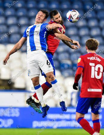 Jonathan Hogg of Huddersfield Town and Bradley Johnson of Blackburn Rovers