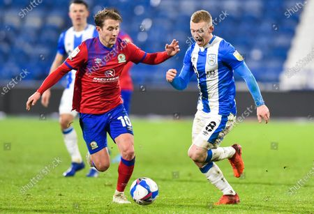 Lewis O'Brien of Huddersfield Town and Lewis Holtby of Blackburn Rovers