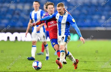 Stock Picture of Lewis O'Brien of Huddersfield Town and Lewis Holtby of Blackburn Rovers