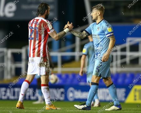 Steven Fletcher #21 of Stoke City and Kyle McFadzean #5 of Coventry City embrace after the game