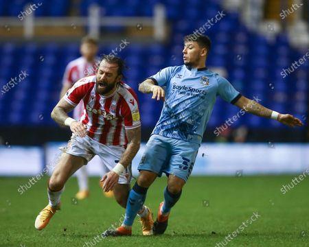 Steven Fletcher #21 of Stoke City is fouled by Gustavo Hamer #38 of Coventry City