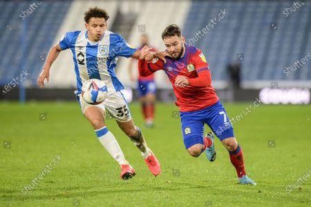 Bradley Johnson #4 of Blackburn Roverst akes on Rarmani EdmondsGreen #35 of Huddersfield Town
