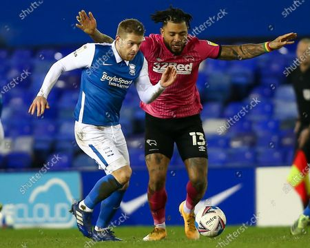 Adam Clayton #8 of Birmingham City dribbles the ball whilst under pressure from Colin Kazim-Richards #13 of Derby County