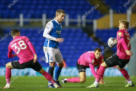 Adam Clayton #8 of Birmingham City watches the ball onto Kamil Jozwiak #7 of Derby County