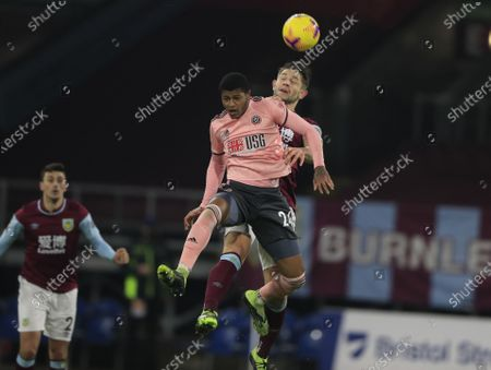 James Tarkowski #5 of Burnley wins the header against Rhian Brewster #24 of Sheffield United