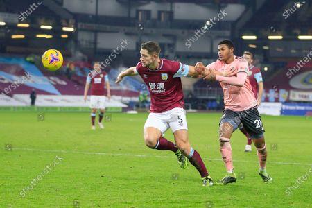 Rhian Brewster #24 of Sheffield United tries to hold back James Tarkowski #5 of Burnley