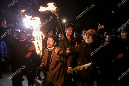 Nepalese protesters perform a torch light protest against the endorsement of the current Nepalese government in Kathmandu, Nepal, 24 December 2020. Nepalese Prime Minister K.P. Sharma Oli, in response to challenges from party rivals, recommended the dissolution of current parliament and called for general election during an emergency cabinet meeting on 20 December. The decision has been ratified by President Bidhya Devi Bhandari, who has called a two-phase election to be held in April and May 2021.