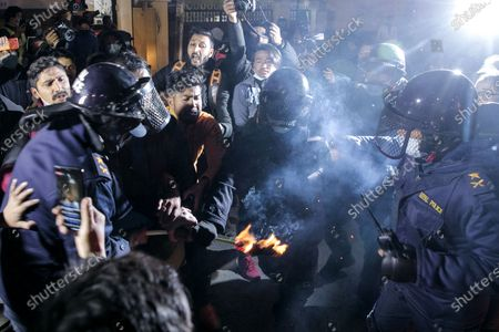 Nepalese protestors clash with security personnel while performing a torch light protest against the endorsement of the current Nepalese government in Kathmandu, Nepal, 24 December 2020. Nepalese Prime Minister K.P. Sharma Oli, in response to challenges from party rivals, recommended the dissolution of current parliament and called for general election during an emergency cabinet meeting on 20 December. The decision has been ratified by President Bidhya Devi Bhandari, who has called a two-phase election to be held in April and May 2021.