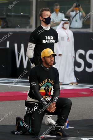 Stock Picture of Shows Mercedes driver Lewis Hamilton of Britain kneeling in support of the Black Lives Matter campaign on the grid before the Formula One at the Yas Marina racetrack in Abu Dhabi, United Arab Emirates