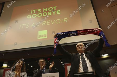 Stock Image of British MEP Richard Corbett holds up a scarf during a ceremony prior to the vote on the UK's withdrawal from the EU, the final legislative step in the Brexit proceedings, at the European Parliament in Brussels. Britain and the European Union have struck a provisional free-trade agreement that should avert New Year chaos for cross-border traders and bring a measure of certainty for businesses after years of Brexit turmoil