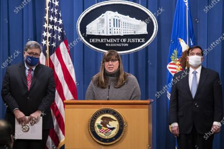 Kara Weipz (C), representative on behalf of the Pan Am 103 victims and their families, delivers remarks beside US Attorney General William Barr (L) and Assistant Attorney General for National Security John Demers (R); during a news conference to provide an update on the investigation of the terrorist bombing of Pan Am flight 103  on the 32nd anniversary of the attack, at the US Department of Justice in Washington, DC, on December 21, 2020. The bombing of Pan Am flight 103 occurred December 21, 1988, killing all 259 people on the plane and eleven on the ground.