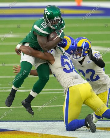 New York Jets running back Frank Gore is tackled in air by Los Angeles Rams Justin Hollins (58) in fourth quarter action at SoFi Stadium in Inglewood, California on Sunday, December 20, 2020. The Jets upset the Rams 23-20.